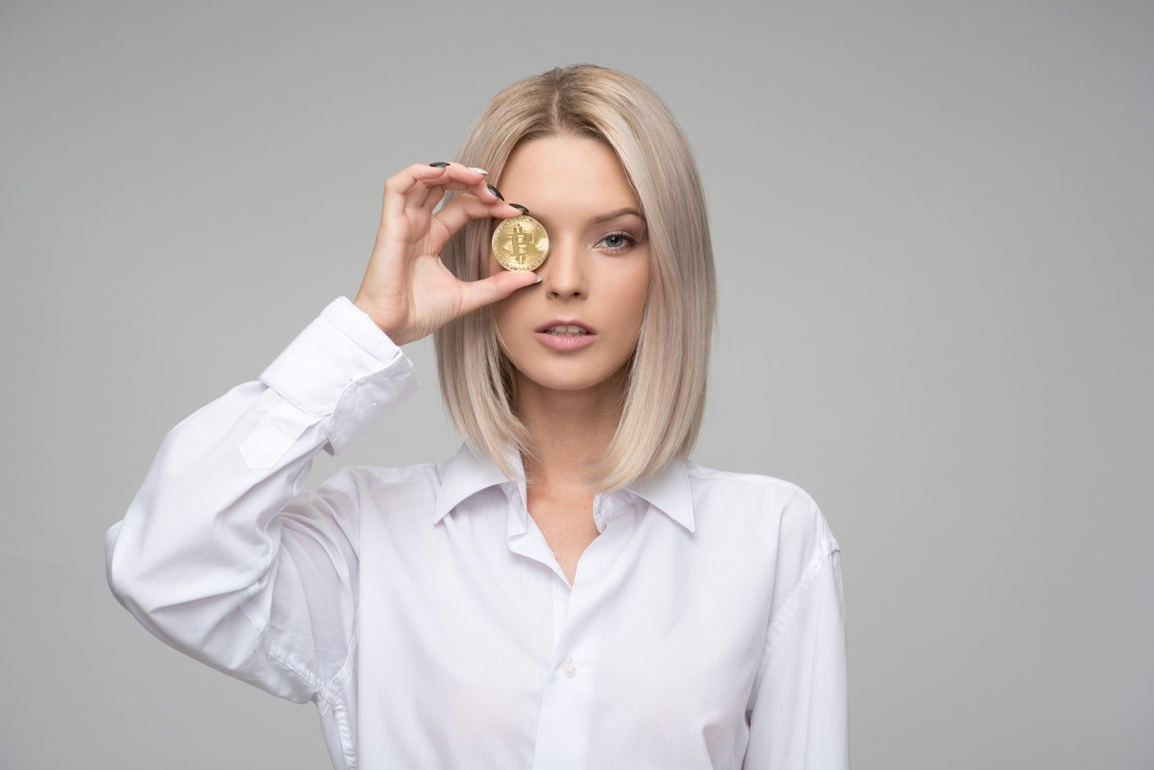 Woman showing cryptocurrency